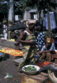 Abidjan, street vendors selling vegetables at market