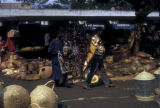 Abidjan, street vendors selling baskets at market