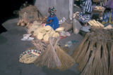 Abidjan, woman street vendor selling brooms at street  market