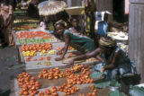 Abidjan, women selling vegetables at street market