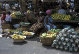 Abidjan, street market with display of fruit and vegetables