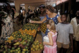 Abidjan, shoppers and vegetable sellers at street market