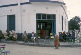Kairouan, patrons sitting outside corner coffee shop