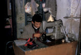 Nefta, tailor working at sewing machine