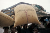 Accra, men carrying bags of cocoa beans for export