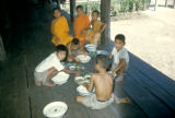 Bangkok, group of boys at mealtime