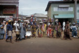 Accra, street scene with women carrying fabrics