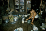 Bangkok, woman preparing meal