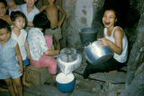 Bangkok, women preparing rice gruel