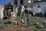 Cape Town, children in yard of dilapidated dwelling
