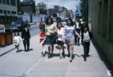 Bogota, group of people walking down street