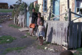 Cape Town, children standing by rickety fence