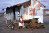 Cape Town, woman in front of tin home