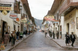 Cuzco, storefronts on cobblestone street