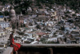 Guanajuato, woman seated on balcony overlooking city