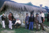 Bogota, workers gathered around stone house