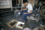 Bangkok, worker making bronze tableware