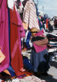 La Paz, woman looking at fabrics at outdoor market