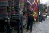 Chichicastenango, fabrics display at outdoor market