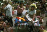 Chichicastenango, woman purchasing yarn in outdoor market