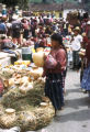 Sololá, woman examing pottery at outdoor market