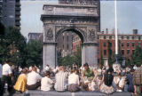 New York, Manhattan, people gathered beneath Washington Square Park Arch