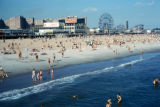 New York, Brooklyn, view of Coney Island beach and boardwalk attractions