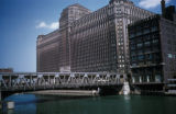 Chicago, Merchandise Mart on Chicago River with Wells Bridge in foreground