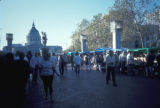 San Francisco, pedestrians at farmers' market in Civic Center Plaza with City Hall in background