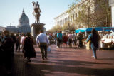 San Francisco, pedestrians at farmers' market, City Hall in background