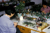 Beijing, craftswomen working on porcelain decorations