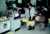 Tokyo, waiting in line at supermarket