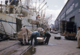 New Orleans, men working at Poydras Street wharf