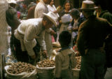 Mexico City, man selling walnuts at Merced farmers' market