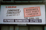 Minneapolis, billboard advertising KDWB radio station and Plywood Minnesota