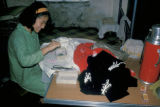 Hong Kong, woman beading sweaters