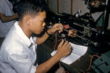 Manila, Filipino vocational student working with electric wiring