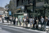 Tehran, people at bus stop
