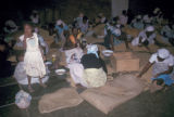 Luanda, sorting coffee beans for export