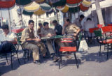 Luanda, soldiers at outdoor café