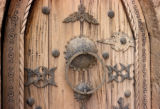 Timbuktu, decorative ironwork on carved wooden door
