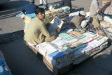 Karachi, street vendor reading newspaper