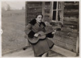 Svanetian woman playing a guitar