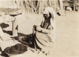 Svanetain woman processing raw wool
