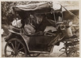 Man resting in a carriage in Svanetia