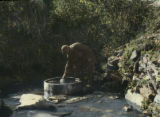 Svanetian man drawing water from a spring