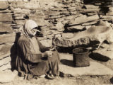 Elderly Svanetian woman spinning wool