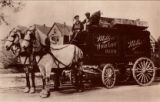 Two men drive Miller Brewing's beer cart