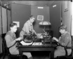 Scouts typing on typewriters