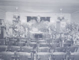 Funeral home interior with open casket